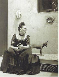 Frida (seated with dog), 1944 - by Lola Álvarez Bravo