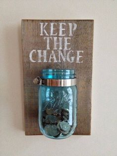 Save the change in a cute homemade mason jar.  Easy to make!  One square board, paint, stencils, mason jar, clip, and screws.