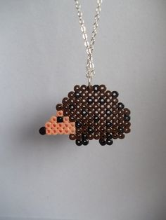 Hama bead hedgehog pendant - could see doing this in pony beads as well Mini Hama Beads, Diy Perler Beads, Pearler Beads, Fuse Beads, Perler Bead Designs, Hama Beads Design, Bead Crafts, Jewelry Crafts, Pixel Beads