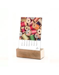 2013 desk calendar with maple base / 2013 calendar, stand, original fine art photography / light wood wooden stand / 5x7 loose pages.  via Etsy.