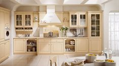 stylish vanilla kitchen cabinets with glass fronts tile flooring