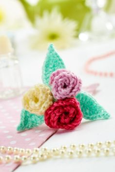 Sweet Tri-Colored Knitted Floral Brooch - free pattern from Let's Knit! This is so cheerful for spring!