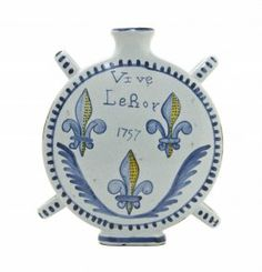 A French Faience Moon Flask, Height 8 1/2 Inches.