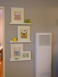 Clever idea for displaying framed images. You can buy these shelves from ikea.