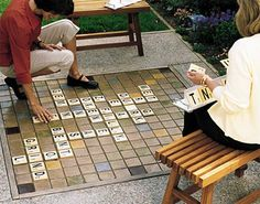Amazing giant outdoor scrabble board!! Must DIY! Pretty sure I could replicate this but on a board with tiles from the habitat restore so we could take it with us when we move.