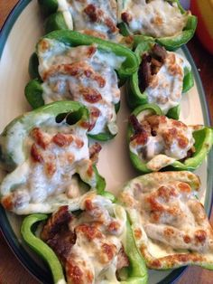 Steak n cheese stuffed peppers with onions.