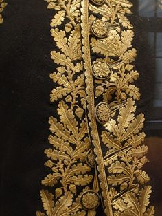 Gold embroidered oak leaves and buttons - French officer's uniform. Gold thread on wool. Hand-embroidered, ca. 1800.