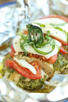 Pesto Caprese Chicken in Foil - Dinner has never been easier with these foil packets - simple wrap and bake. SO EASY! And the leftovers taste even better!