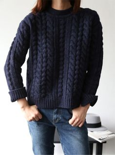 cable knit pullover and jeans