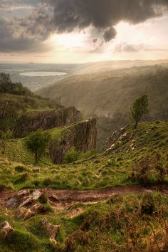 Cheddar Gorge, in Cheddar. Britain's biggest gorge from the dramatic cliffs rising 450ft to the stunning stalactite caverns. This world-famous beauty spot is a National Nature Reserve, reveals many fascinating stories of our prehistoric ancestors, and is an international centre for caving and rock climbing: - photographed by Graham Mcpherson