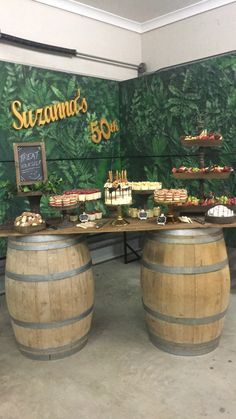 Rustic Dessert Table  * Wine barrels * Table top * Custom backdrop  * Wooden & gold cake stands