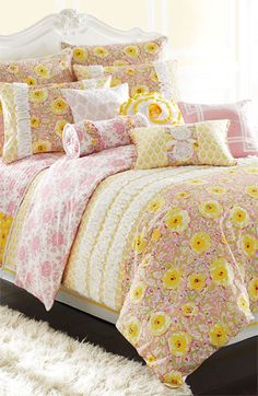 Appliquéd ruffles ripple over a mixed-print comforter lit with sunny color, by Dena™ Home.
