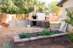 Stone veneer over cinder block raised garden bed. How to Build a Raised Garden Bed Tutorial | Tikkido.com