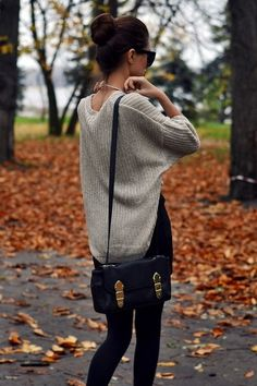 neutral sweater, black and gold purse