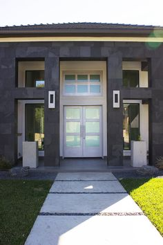 Solara's newest completion of our beautiful Roe door design. Notice how the entrance modernizes the home's exterior.