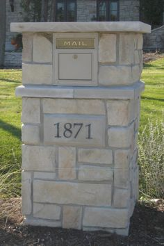 Add a stone mailbox when adding stone veneer to your home. Limestone and address stone. Project in Libertyville, IL  www.northstarstone.biz  call 847-996-6850