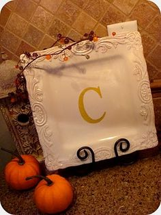 Plate Monogram. This easy little project makes a decorative plate more personalized. Great for your own home or as a gift. Homegood's has a wide selection of display plates and nice variety of seasonal plates as well.