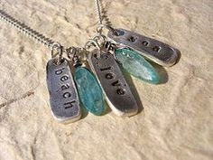 Ah I want this except mine will say Toast, melted, Texas hmm~ or King,Kitty, Love yeah I know random but cute!! Shabby Chic Designs HAND STAMPED Fine Silver Tiny Beach Tags Necklace