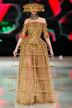9. Alexander McQueen Spring 2013. Crinoline Period. Understructure used during this period for fullness.