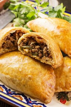"""Originally from Galicia, Spain, empanadas now exist in over 30 countries in some shape or form. The name comes from """"empanar"""", which means """"to bread"""" in Spanish and Portuguese. Beef Empanadas, Peruvian Recipes, Empanadas Recept, Donut Recipes, Mexican Food Recipes, Keto Recipes, Cooking Recipes, Gastronomia, Snacks"""