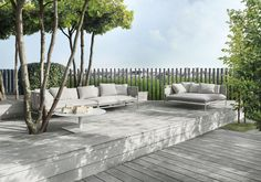 minimalist outdoor seating areas with wood decking, simple vertical fence details
