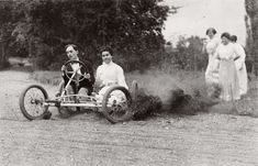 Yes, it's a car. Though it seems more like an early dune buggy. A man and a woman go for a wild, dusty ride through a field while a group of women follow on foot. 1928