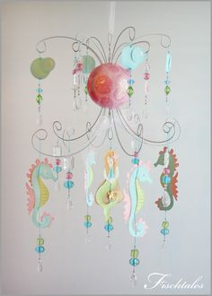 Mermaid Chandelier Mobile- Baby Mobile- Nursery Mobile. $155.00, via Etsy. This is so whimsical! This would be an awesome light fixture or just hanging over a bed or a play table.