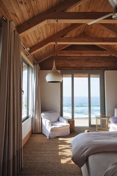 seagrass carpet love!..beams and ceiling is amazing Check out this whole house. Love especially the kitchen windows