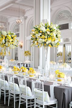 Beautiful tall arrangements for the tables. For planning inspiration and advice go to www.tidesevents.co.uk