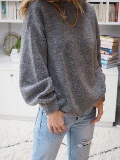 grey knit  light blue jeans