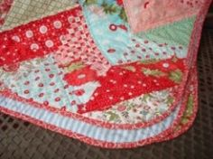 For most quilters, binding the edges of a quilt is the last major step in completing the project. But how do you bind the edges if the quilt isn't a basic straight-sided shape? Or what if you prefer to have and un-bordered look? One good answer is...