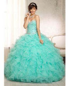 Quinceanera Dress #88094 Crystal Beaded Bodice on a Ruffled Organza Skirt. Matching Bolero Included. Colors Available: Iced Pink, Mint, White.