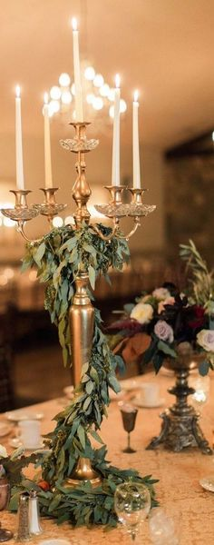 greenery candlestick wedding centerpiece ...Beautiful. Would add more flowers maybe...