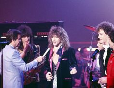 American Bandstand hosted by Dick Clark with Bon Jovi. Great Bands, Cool Bands, American Bandstand, 80s Music, Jon Bon Jovi, Rock Legends, My Emotions, Early American, Famous Faces