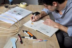 tommaso caldera sketching the tull lamp workshop lighting