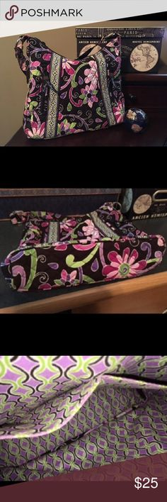 Vera Bradley Handbag- Brown, Green,  & Pink Floral Medium-sized like-new Vera Bradley shoulder bag with a dark brown, green, and pink floral pattern. It's in excellent condition and barely used. Very cute handbag!   Top zipper closure Two outside zipper pocket Two inner open pockets Measurements:  Strap drop- 11 inches  Depth- 9.25 inches Length across, measuring the bottom- 12 inches Vera Bradley Bags Shoulder Bags
