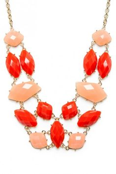 red + peach statement necklace.