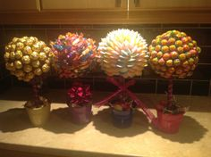 Sweet trees  Chupa chups lollies, Ferrero Rocher, Roses and flying saucers!!!   Easily made!!!