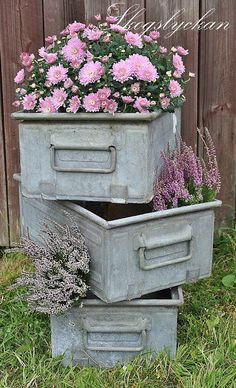 Zinc containers filled with flowers