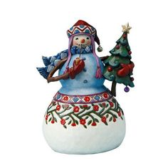 A traditional snowman all bundled up for the season. He has a fancy Christmas tree and is smoking a pipe.