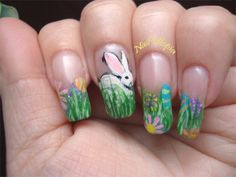 NailUtopia shared this cute bunny hiding in grass with Easter eggs