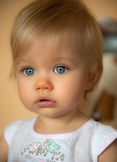 Beautiful little girl. Very similar features to Olive. But shell never be that tanned :-p