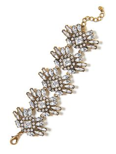 This vintage-inspired crystal bracelet, accentuated with princess and marquise cut gems, add that polishing touch of sophisticated sparkle to an already glam ensemble.