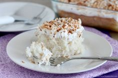A delicious coconut cream poke cake from Dessert Now, Dinner Later!