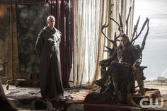 "The 100 -- ""Ye Who Enter Here"" -- Image HU303b_0151 -- Pictured (L-R): Neil Sandilands as Titus and Alycia Debnam-Carey as Lexa -- Credit: Cate Cameron/The CW -- © 2016 The CW Network, LLC. All Rights Reserved"