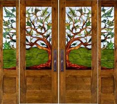 Beautiful stained glass tree carried through 4 panels- by calarchitecturaltraditions.com