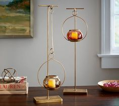 """Pendulum Candle Stand   Pottery Barn  7"""" wide x 3"""" deep x 22"""" high.  Crafted of iron with a brass finish. $39.50 (brown)"""
