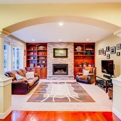 sale A family room with beautiful built-ins and an inviting fireplace, is an ideal pl...
