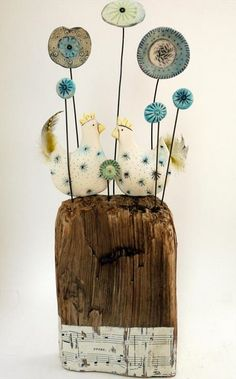 Mr Bilby in his party hat.. Original. earthenware,driftwood vintage tape measure. 10cm x 7cm x 3.5cm. Can be seen at Rostra Gallery. Sold.