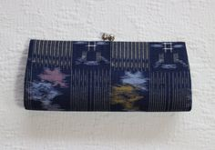 Vintage Japanese clutch purse in very good condition The clutch is covered in beautifully woven cotton Lovely kasuri/ikat geometric patterns Indigo blue with white, lighter blue, yellow and red Purple lining is intact and clean Snaps shut securely Versatile, Great for everyday use or semi formal occasions Measurements: Length 25.5 cm // 10 inches Width 11 cm // 4.3 inches (excluding clasp) Depth 4 cm // 1.6 inches (at deepest point)  Free Air Mail Shipping Clutch will be shipped boxed